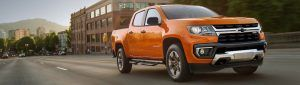 Front side view of 2021 Chevrolet Colorado driving in a town